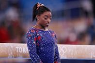 """<p>On July 25, Biles and the U.S. women's gymnastics roster competed in the qualifying round and <a href=""""https://people.com/sports/tokyo-olympics-simone-biles-team-usa-uncharacteristically-sloppy-errors-qualifying-round/"""" rel=""""nofollow noopener"""" target=""""_blank"""" data-ylk=""""slk:made uncharacteristic errors"""" class=""""link rapid-noclick-resp"""">made uncharacteristic errors</a> that ultimately put them in second with a score of 170.562, behind Russia who were 1.067 points ahead of the Americans.</p> <p>It was the first time in 11 years at a world championships or Olympics that the U.S. failed to top the women's gymnastics team leaderboard.</p> <p>Biles, who qualified for every women's gymnastics medal event at the Tokyo Games, finished first in the individual all-around despite errors on all but one apparatus. On floor, she stepped out of bounds. On vault, she stepped off the mat on her landing when she attempted the Cheng, a half-twist onto the vaulting table and a straight-legged front flip with 1.5 twist. The uneven bars, her second to last apparatus, was the only one Biles completed without an issue. Then on the balance beam, she stumbled after her dismount.</p>"""