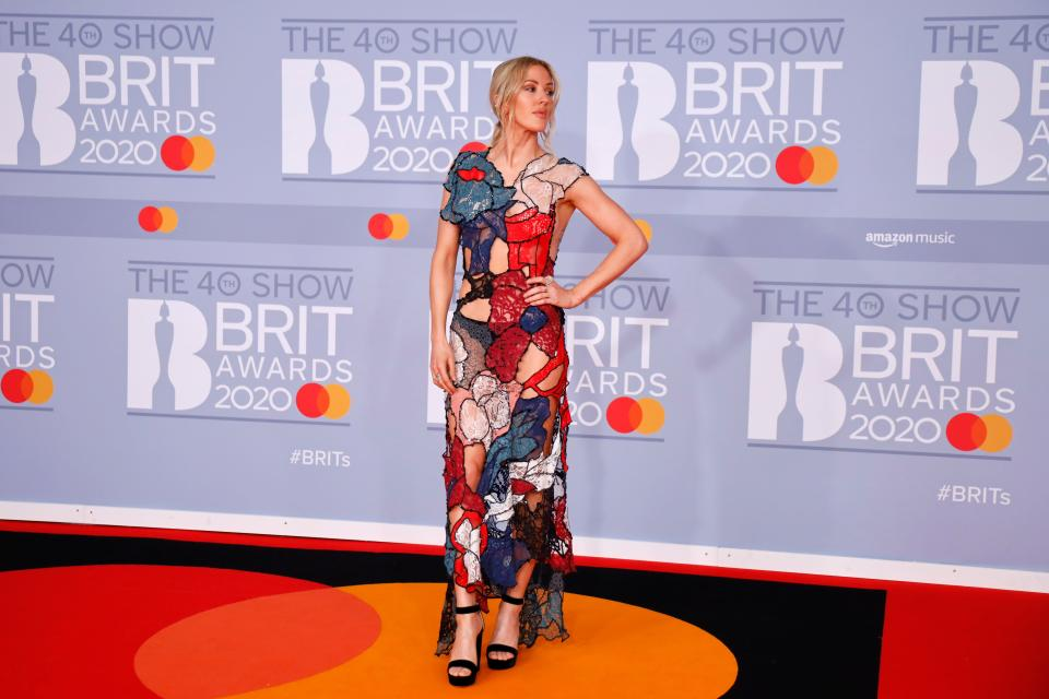 Ellie Goulding's colourful cut-out gown has been paired with a pair of simple heels and pulled back hair for maximum effect. This outfit really is all about the dress. (Getty Images)