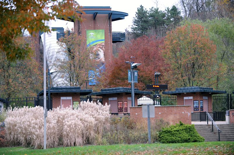 This photo taken Sunday, Nov. 4, 2012 shows the exterior view of the front entrance of the Pittsburgh Zoo, where zoo officials say a young boy was killed after he fell into the exhibit that was home to a pack of African painted dogs, who pounced on the boy and mauled him. It's not clear whether he died from the fall or the attack, said Barbara Baker, president and CEO of the Pittsburgh Zoo & PPG Aquarium. (AP Photo/John Heller)