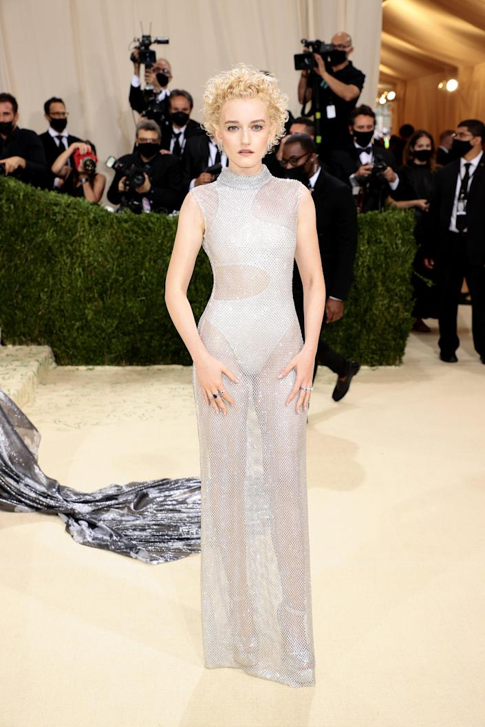 """<h2>Julia Garner wearing Stella McCartney</h2><br>Julia Garner dressed for the screen in this silver, naked-esque dress by Stella McCartney. <span class=""""copyright"""">Photo by Dimitrios Kambouris/Getty Images for The Met Museum/Vogue </span>"""
