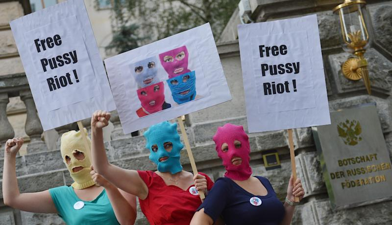 Masked female activists demonstrate in support of members of the feminist punk group Pussy Riot in front of the Russian Embassy in Berlin, Germany, Thursday Aug. 9, 2012. Prosecutors in Russia on Tuesday called for three-year prison sentences for feminist punk rockers who gave an impromptu performance in Moscow's main cathedral to call for an end to Vladimir Putin's rule, in a case that has caused international outrage and split Russian society. (AP Photo/dapd/Oliver Lang)