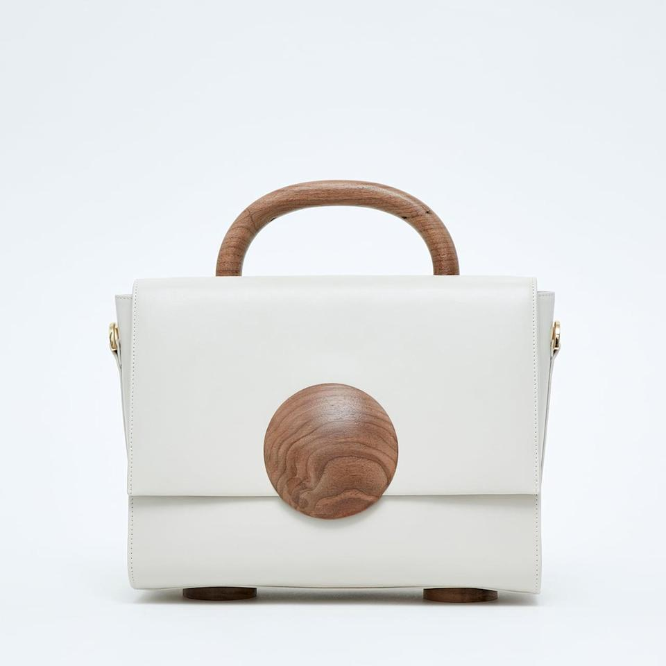 <p>Bakari is known for its fun, geometric-shaped purses. Every item by the brand is handmade using sustainable or recycled materials. The company even gives a percentage of each purchase to a charity. </p> <p><strong>What We'd Buy</strong>: <span>Bakari Tussaud Wood Bag </span> ($633)</p>