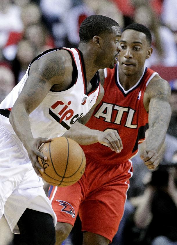 Portland Trail Blazers guard Wesley Matthews, left, drives on Atlanta Hawks guard Jeff Teague during the first half of an NBA basketball game in Portland, Ore., Wednesday, March 5, 2014. (AP Photo/Don Ryan)