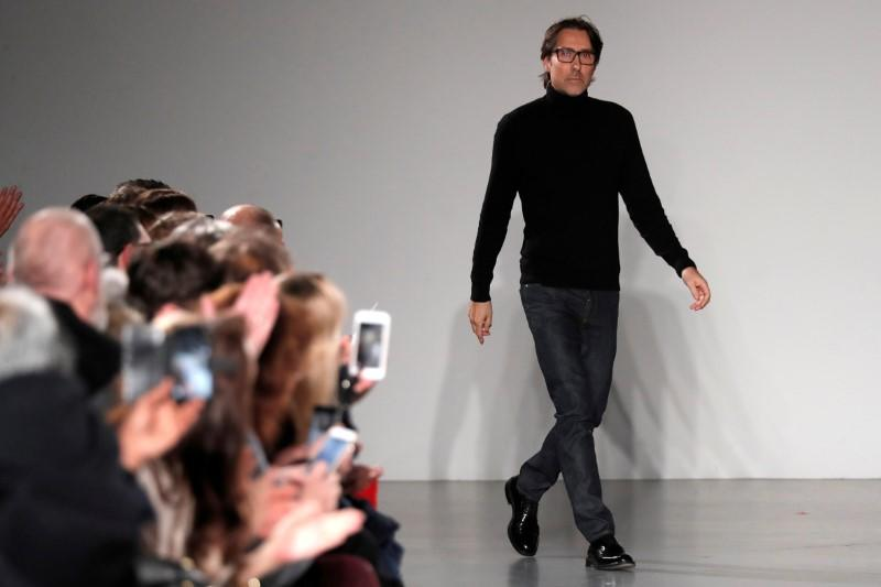 FILE PHOTO: French designer Christophe Josse appears at the end of his Haute Couture Spring-Summer 2018 fashion show in Paris