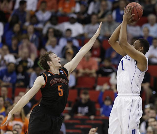 Duke forward Jabari Parker (1) shoots against Mercer forward Bud Thomas (5) during the first half of an NCAA college basketball second-round game, Friday, March 21, 2014, in Raleigh, N.C. (AP Photo/Chuck Burton)