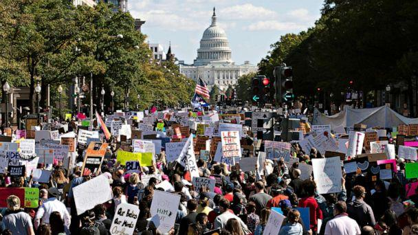 PHOTO: With the U.S Capitol in the background, demonstrators march on Pennsylvania Av. during the Women's March in Washington, Oct. 17, 2020. (Jose Luis Magana/AP)