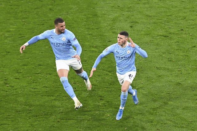 Foden (right) scored in both legs of City's triumph over Dortmund