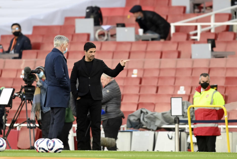 Arsenal's manager Mikel Arteta, right, speaks with Everton's manager Carlo Ancelotti before the English Premier League soccer match between Arsenal and Everton at the Emirates stadium in London, Friday, Apr 23, 2021. (Michael Regan/Pool via AP)