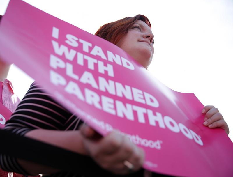 Activists participate in a rally to support Planned Parenthood: Getty Images