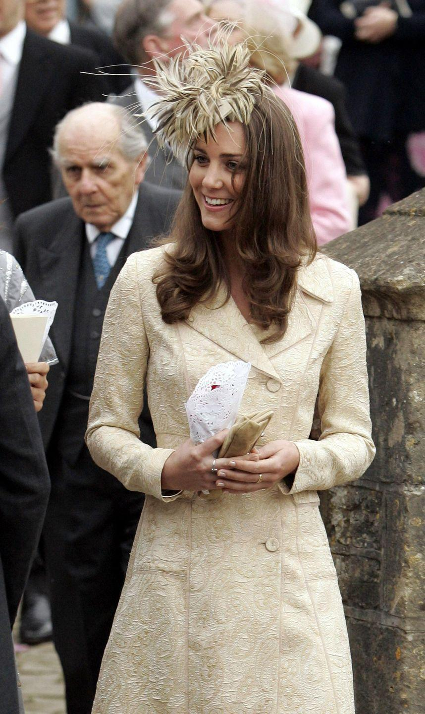 <p>To attend the wedding of Laura Parker-Bowles and hang out with her future in-laws, Kate wore this gold paisley coat by Day Birger et Mikkelsen paired with a really fun fascinator. It looks like a sea anemone!</p>