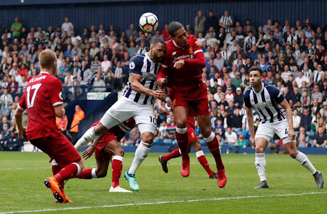 """Soccer Football - Premier League - West Bromwich Albion v Liverpool - The Hawthorns, West Bromwich, Britain - April 21, 2018 West Bromwich Albion's Matt Phillips in action with Liverpool's Virgil van Dijk Action Images via Reuters/Andrew Boyers EDITORIAL USE ONLY. No use with unauthorized audio, video, data, fixture lists, club/league logos or """"live"""" services. Online in-match use limited to 75 images, no video emulation. No use in betting, games or single club/league/player publications. Please contact your account representative for further details."""