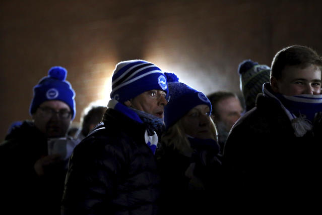 Brighton and Hove Albion soccer fans arrive for the Premier League match against Bournemouth, at the Vitality Stadium in Bournemouth, England, Tuesday Jan. 21, 2020. (Mark Kerton/PA via AP)