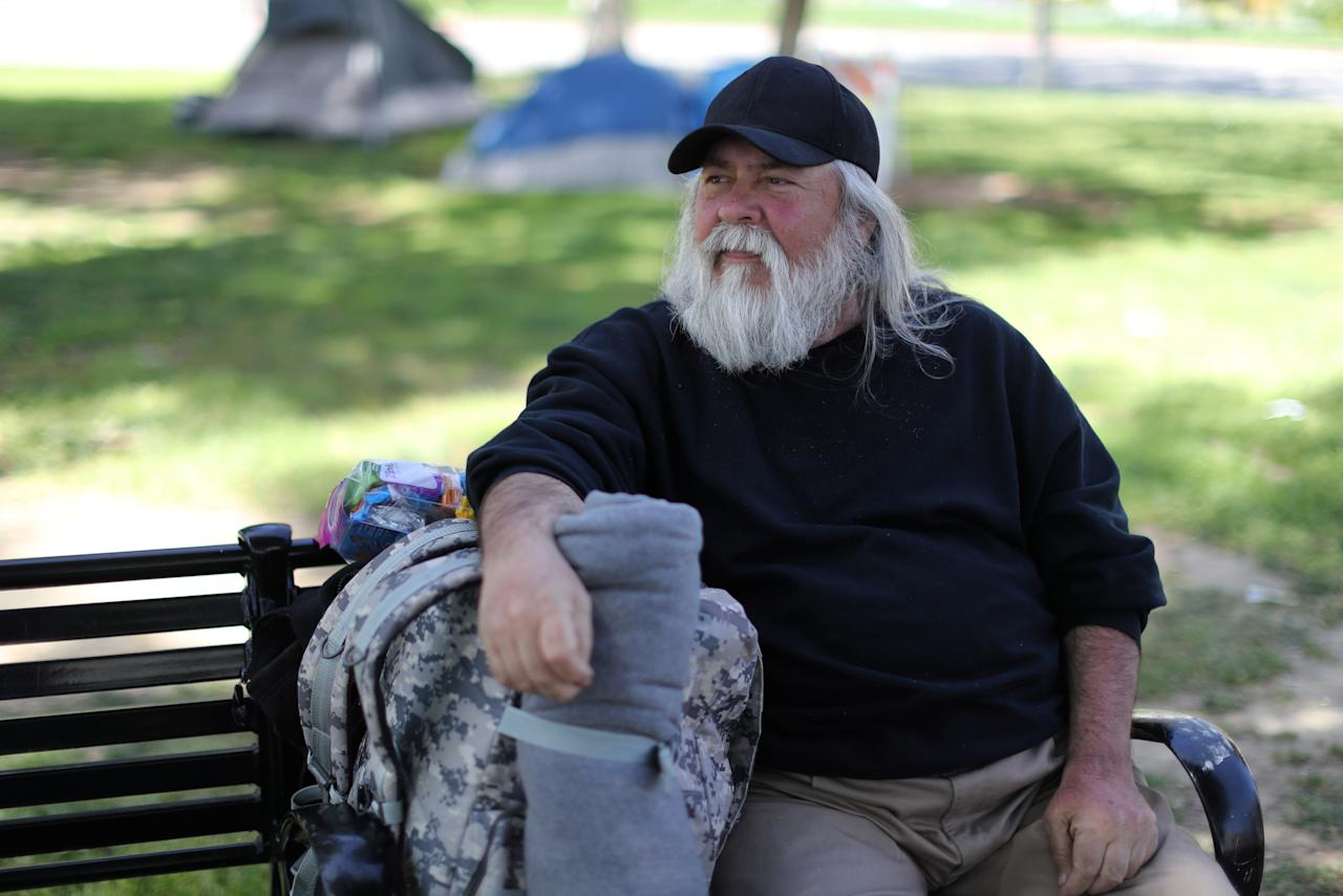 Fernando Ochoa, 65, who has been homeless for a week, sits on a park bench in Los Angeles, California, U.S. April 11, 2018. Ochoa said he had worked as a foreman for Albertson's and a Service Advisor for Honda but is now retired and is looking for housing. Picture taken April 11, 2018. REUTERS/Lucy Nicholson