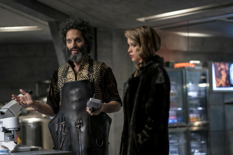 """This image released by Paramount Plus shows Jason Mantzoukas, left, and Sophie Cookson in a scene from """"Infinite."""" (Peter Mountain/Paramount+ via AP)"""