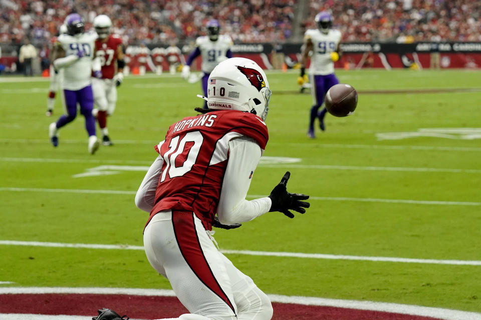 Arizona Cardinals wide receiver DeAndre Hopkins (10) pulls in a touchdown catch against the Minnesota Vikings during the first half of an NFL football game, Sunday, Sept. 19, 2021, in Glendale, Ariz. (AP Photo/Rick Scuteri)