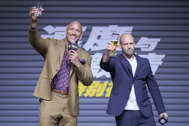 Jason Statham (R) and Dwayne Johnson attend the 'Fast & Furious: Hobbs & Shaw' press conference on August 5, 2019. (Visual China Group via Getty Images/Visual China Group via Getty Images)