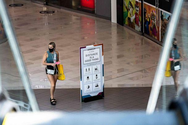 PHOTO: A shopper wearing a face mask walks through the Mall of America on June 16, 2020 in Bloomington, Minn. (Kerem Yucel/AFP via Getty Images)