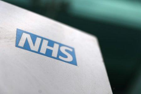 FILE PHOTO: An NHS logo is displayed outside a hospital in London, Britain May 14, 2017. REUTERS/Neil Hall