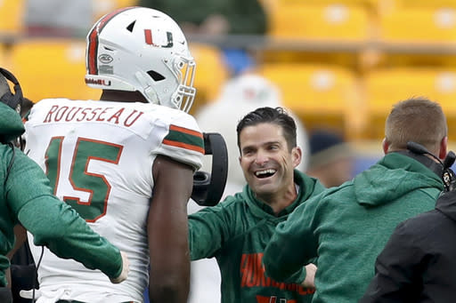 FILE - Miami defensive lineman Gregory Rousseau (15) celebrates with head coach Manny Diaz in the second half of an NCAA college football game against Pittsburgh, Saturday, Oct. 26, 2019, in Pittsburgh. Miami won 16-12. The Hurricanes open the season Sept. 10 at home against UAB, with Miami looking for much better play from the offense in 2020. (AP Photo/Keith Srakocic, File)