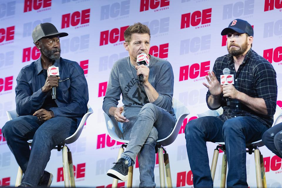 SEATTLE, WA - JUNE 29:  (L-R) Don Cheadle, Jeremy Renner and Chris Evans react after Chris Evans drops and F-Bomb while speaking during ACE Comic Con at Century Link Field Event Center on June 28, 2019 in Seattle, Washington.  (Photo by Mat Hayward/Getty Images)