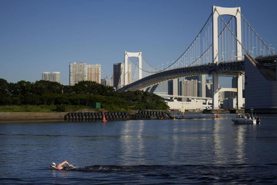 Backdropped by the Rainbow Bridge, Florian Wellbrock, of Germany, competes in the men's marathon swimming event at the 2020 Summer Olympics, Thursday, Aug. 5, 2021, in Tokyo, Japan. (AP Photo/Jae C. Hong)