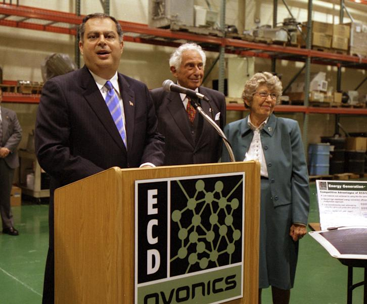 FILE - This Aug. 23, 2002 file photo shows Stanford Ovshinsky, center, co-founder of Energy Conversion Devices Inc. with his wife Iris, right, appeared with U.S. Secretary of Energy Spencer Abraham at a news conference at the company's offices in Rochester Hills, Mich., on Aug. 23, 2002. Stan Ovshinsky, 89, died Wednesday, Oct. 17, 2012, at his home in Bloomfield Hills from complications of prostate cancer. (AP Photo/Kathleen Wayt, file)