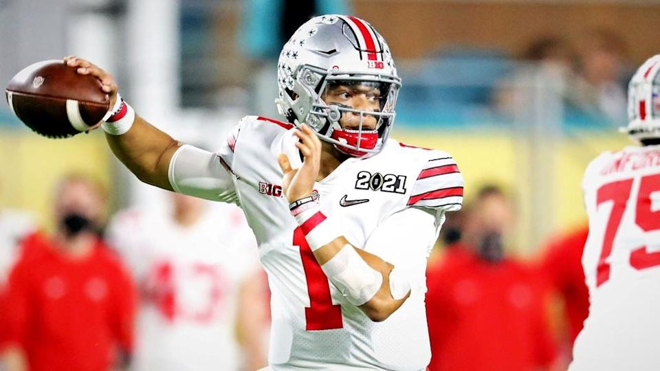 Jan 11, 2021; Miami Gardens, Florida, USA; Ohio State Buckeyes quarterback Justin Fields (1) throws a pass during the first quarter against the Alabama Crimson Tide in the 2021 College Football Playoff National Championship Game. Mandatory Credit: Mark J. Rebilas-USA TODAY Sports