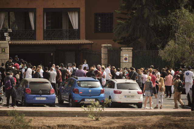 Hotel workers queue to get tested at the H10 Costa Adeje Palace hotel in Tenerife. (AP)