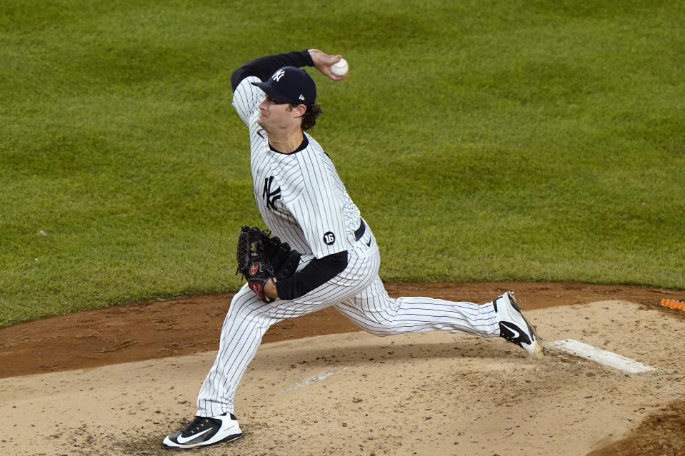 New York Yankees starting pitcher Gerrit Cole winds up during the fourth inning of a baseball game against the Baltimore Orioles, Tuesday, April 6, 2021, at Yankee Stadium in New York. (AP Photo/Kathy Willens)
