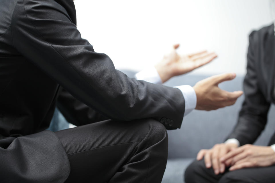 Hands of a businesswoman and businessman in meeting.