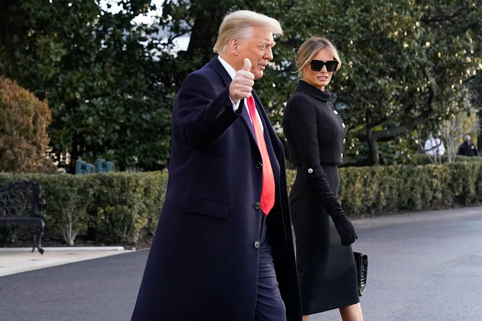 President Donald Trump and first lady Melania Trump walk to board Marine One on the South Lawn of the White House on Jan. 20, 2021.