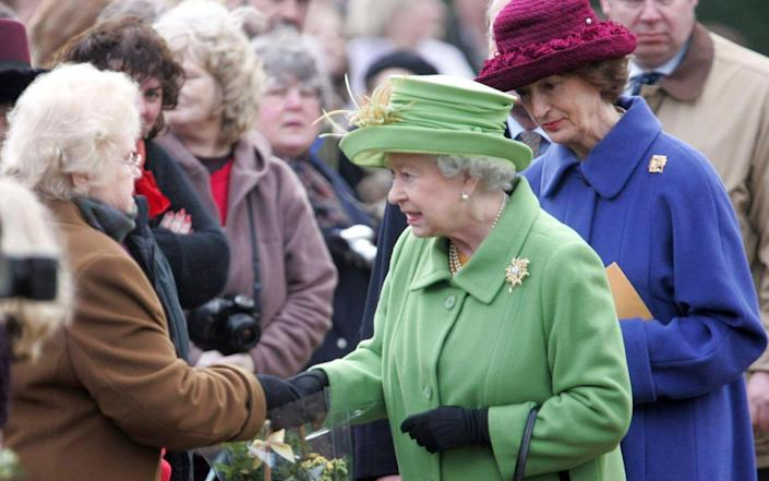 The Queen with lady-in-waiting Lady Susan Hussey (far right) during a 2005 walkabout at Sandringham House in Norfolk - Tim Rooke/Shutterstock