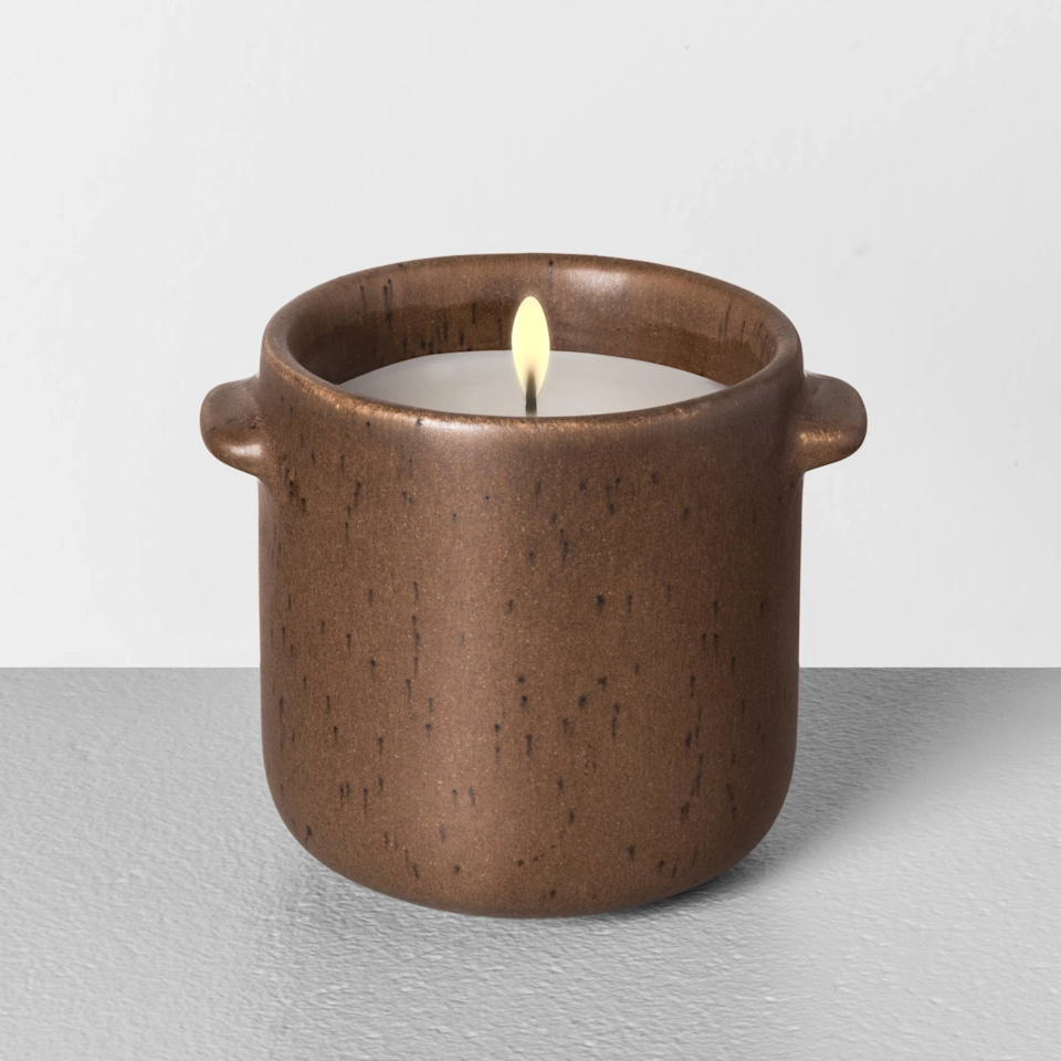 """<h3>Hearth & Hand With Magnolia Fireside Candle</h3><br>""""It's lovely! Reminds me of a fall day, burning leaves with just a hint of spice,"""" one enthused reviewer raves about this woodsy, pine, and clove-essenced candle. <br><br><strong>Hearth & Hand with Magnolia</strong> Seasonal Ceramic Candle Fireside, $, available at <a href=""""https://go.skimresources.com/?id=30283X879131&url=https%3A%2F%2Fgoto.target.com%2Fo29yY"""" rel=""""nofollow noopener"""" target=""""_blank"""" data-ylk=""""slk:Target"""" class=""""link rapid-noclick-resp"""">Target</a>"""