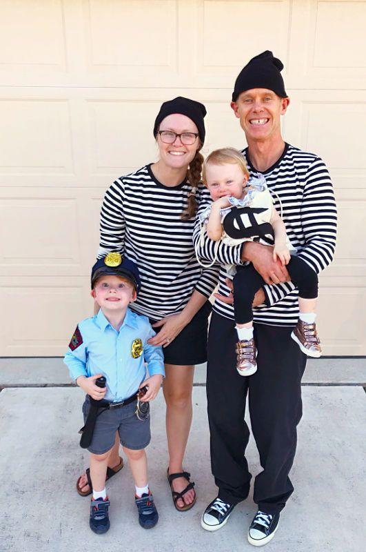 """<p>You'll definitely <em>steal</em> the show with this matching ensemble. Whether you or your child decides to be the police officer, it's a funny family costume either way.</p><p><strong>Get the tutorial at <a href=""""https://lifeanchored.com/cops-and-robbers-family-halloween-costume-diy/"""" rel=""""nofollow noopener"""" target=""""_blank"""" data-ylk=""""slk:Life Anchored"""" class=""""link rapid-noclick-resp"""">Life Anchored</a>. </strong></p><p><a class=""""link rapid-noclick-resp"""" href=""""https://www.amazon.com/Top-Level-Unisex-Cuffed-Toboggan/dp/B01LZ27V22/ref=sr_1_2?dchild=1&keywords=black+beanie+hat&qid=1626969323&sr=8-2&tag=syn-yahoo-20&ascsubtag=%5Bartid%7C10050.g.29074815%5Bsrc%7Cyahoo-us"""" rel=""""nofollow noopener"""" target=""""_blank"""" data-ylk=""""slk:SHOP BLACK BEANIES"""">SHOP BLACK BEANIES </a></p>"""