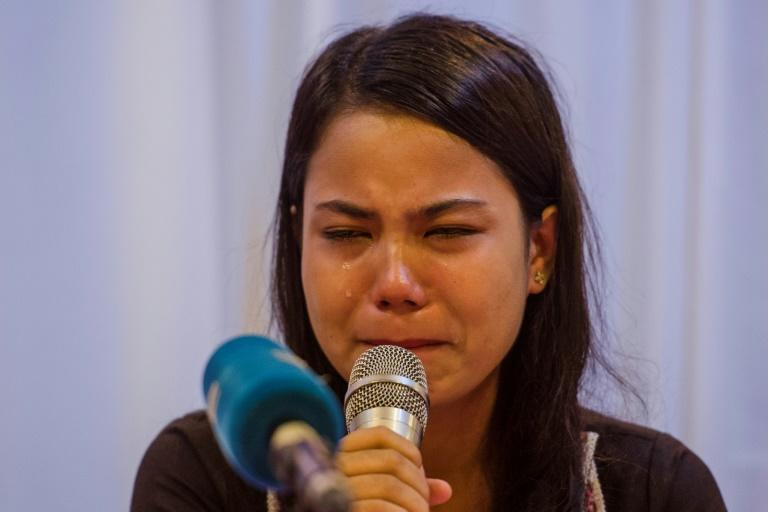 Chit Su Win, wife of detained Reuters journalist Kyaw Soe Oo, breaks down while speaking at a press conference