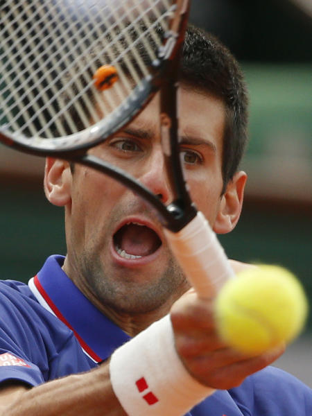 Serbia's Novak Djokovic returns the ball to Germany's Philipp Kohlschreiber during their fourth round match of the French Open tennis tournament at the Roland Garros stadium Monday, June 3, 2013 in Paris. (AP Photo/Michel Spingler)