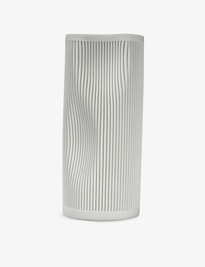 """Working with Corian, a durable surface material used on kitchen counters and in bathrooms, often results in a lot of oddly shaped scraps. London-based design studio GoodWaste saves these leftovers from ending up in landfills by remolding them into sleek flower vases. Available in four different shades of white, they look a bit like raw marble, and the linear grooves and curvy concaves make every piece unique. $215, Selfridges. <a href=""""https://www.selfridges.com/US/en/cat/goodwaste-bra-corian-vase-25cm_R03649431/"""" rel=""""nofollow noopener"""" target=""""_blank"""" data-ylk=""""slk:Get it now!"""" class=""""link rapid-noclick-resp"""">Get it now!</a>"""