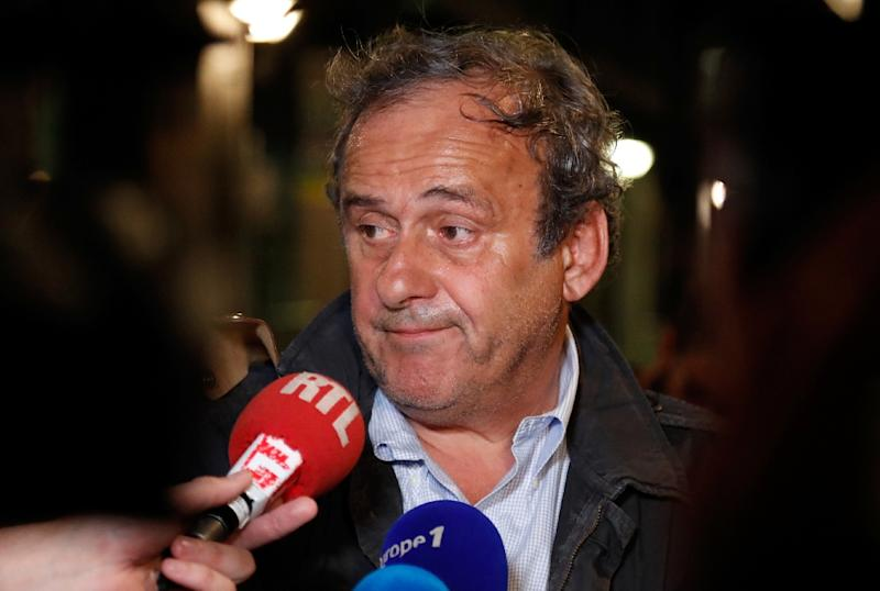 Ex-UEFA chief Michel Platini talks to the media after being questioned in Nanterre as part of a criminal investigation into the awarding of the 2022 World Cup to Qatar