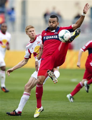 In this photo provided by the Chicago Fire, Chicago Fire forward Maicon Santos, right, kicks the ball away from New York Red Bulls defender Markus Holgersson during the first half of an MLS soccer match, Sunday, April 7, 2013, in Bridgeview, Ill. The Fire won 3-1. (AP Photo/Chicago Fire, Brian Kersey)