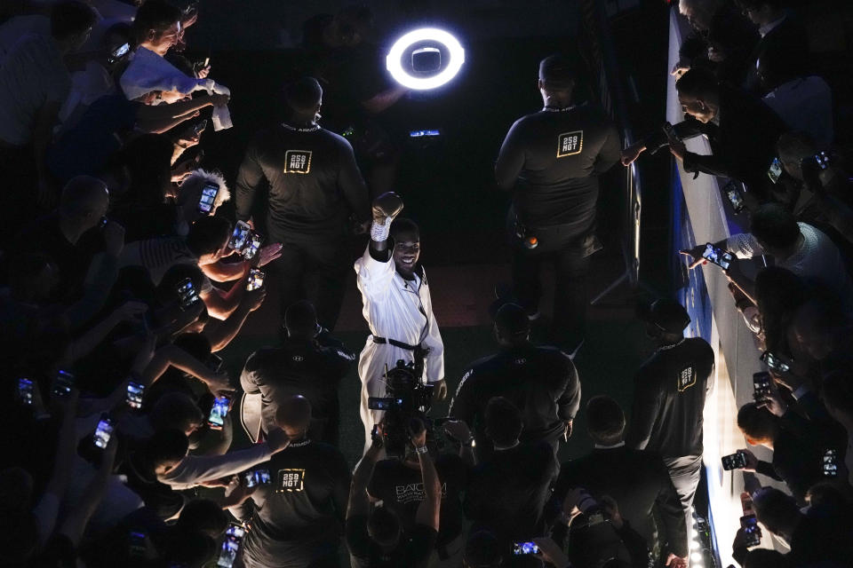 Anthony Joshua of Britain arrives for his fight with Oleksandr Usyk of Ukraine before their WBA (Super), WBO and IBF boxing title bout at the Tottenham Hotspur Stadium in London, Saturday, Sept. 25, 2021. (AP Photo/Frank Augstein)