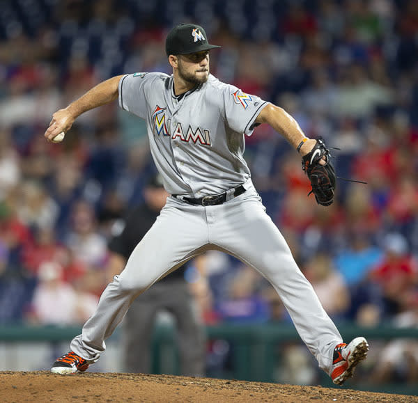 FILE - In this Aug. 2, 2018, file photo, Miami Marlins relief pitcher Kyle Barraclough throws against the Philadelphia Phillies, in Philadelphia. Barraclough lost his arbitration case, and was was given a $1,725,000 salary instead of his $2 million request. (AP Photo/Laurence Kesterson, File)