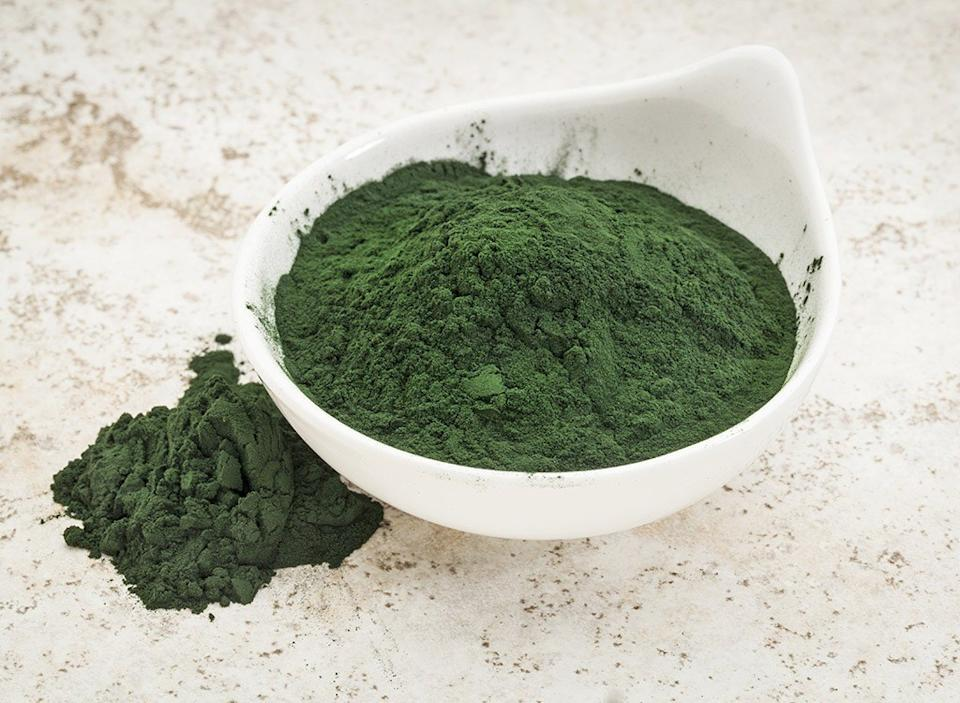 spirulina powder in white bowl