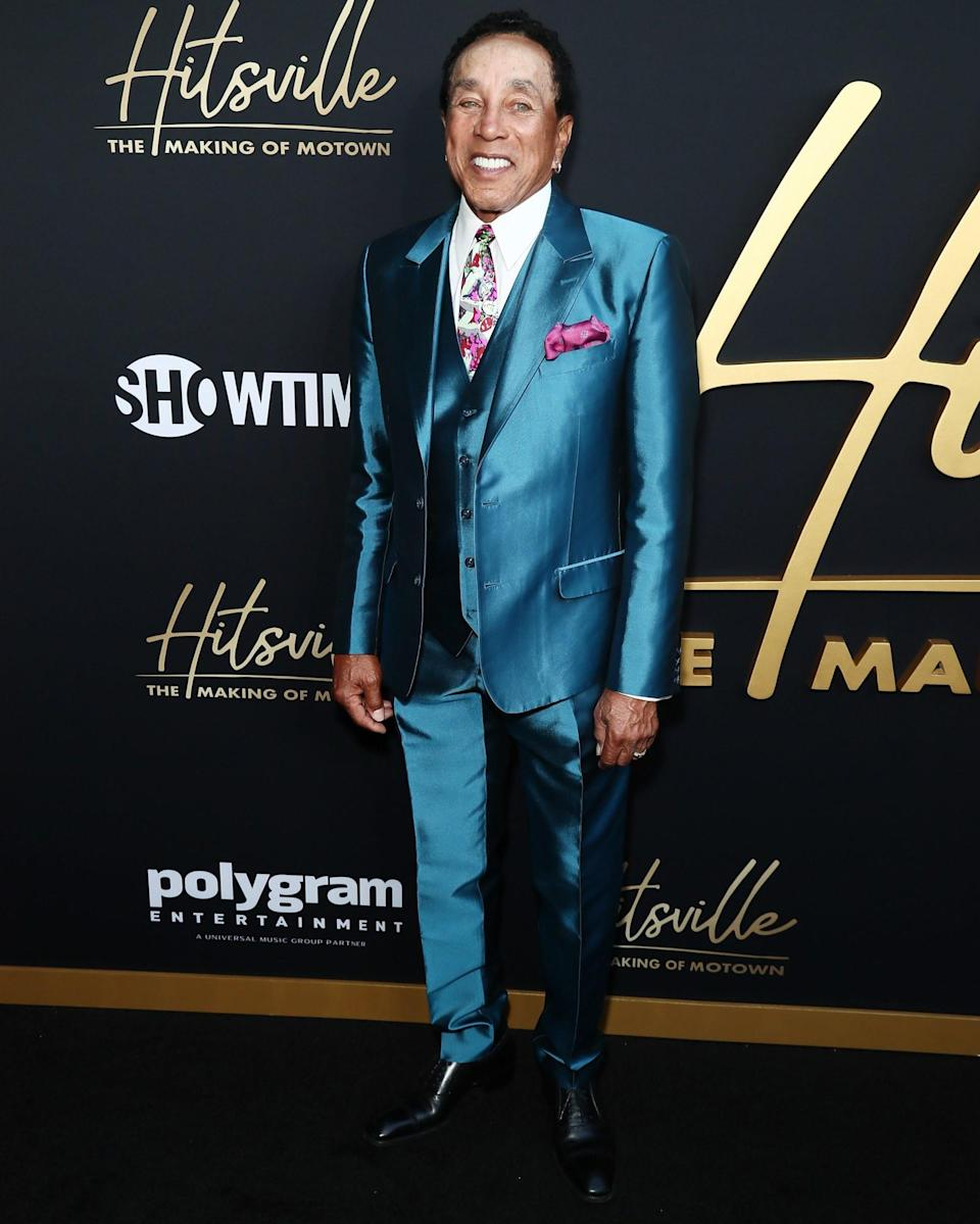 """<h1 class=""""title"""">August 9: Smokey Robinson</h1> <div class=""""caption""""> Smokey Robinson's shiny suit has really got a hold on us. </div> <cite class=""""credit"""">Leon Bennett</cite>"""