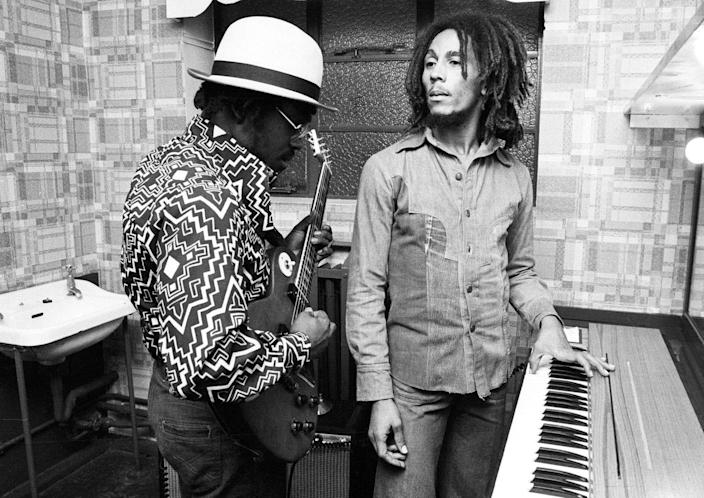 <p>Aston 'Family Man' Barrett and Bob Marley of The Wailers playing guitar and keyboards backstage at the Odeon, Birmingham, United Kingdom, July 18, 1975.</p>