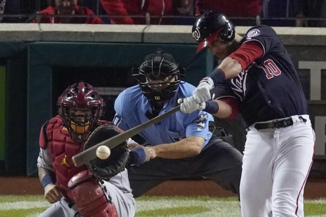Washington Nationals' Yan Gomes hits a two-run scoring single during the first inning of Game 4 of the baseball National League Championship Series against the St. Louis Cardinals Tuesday, Oct. 15, 2019, in Washington. (AP Photo/Alex Brandon)