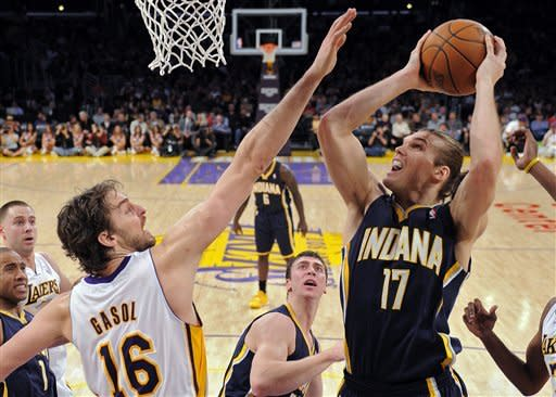 Indiana Pacers center Louis Amundson, right, puts up a shot as Los Angeles Lakers forward Pau Gasol of Spain defends during the first half of their NBA basketball game, Sunday, Jan. 22, 2012, in Los Angeles, Calif. (AP Photo/Mark J. Terrill)