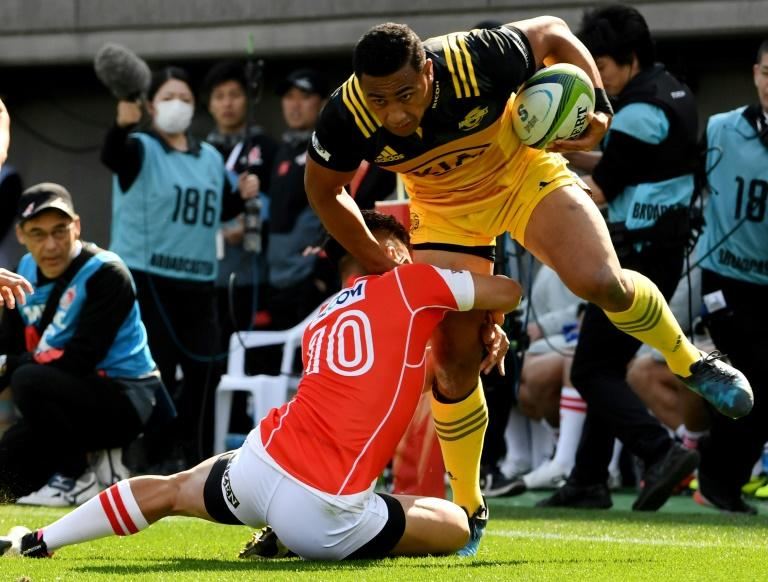 Ngani Laumape of the Wellington Hurricanes (R) is tackled by Hikaru Tamura of Sunwolves during their Super Rugby match, at Prince Chichibu Memorial stadium in Tokyo, on February 25, 2017