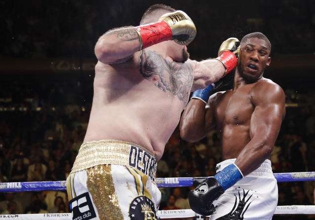 Andy Ruiz, left, punches Anthony Joshua during the third round of a heavyweight title boxing match Saturday, June 1, 2019, in New York. Ruiz won in the seventh round. (AP Photo/Frank Franklin II)