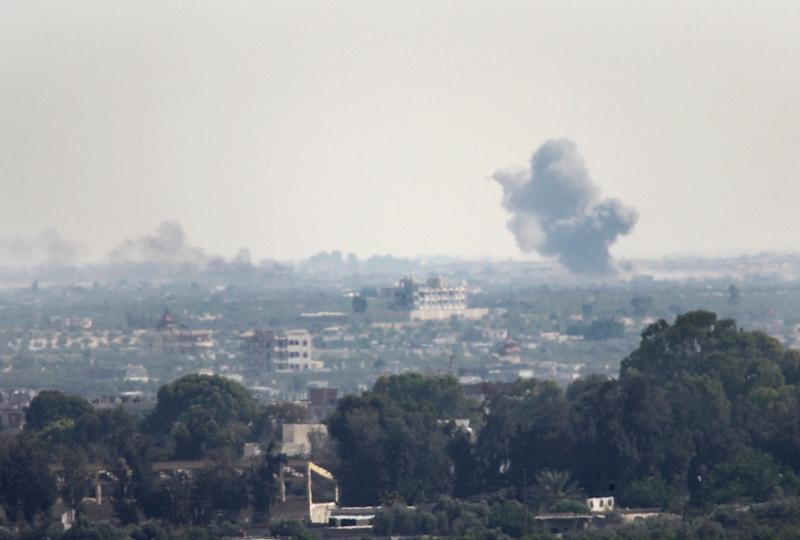 A picture taken from the Rafah border of the southern Gaza Strip with Egypt shows smoke billowing in Egypt's North Sinai on July 2, 2015