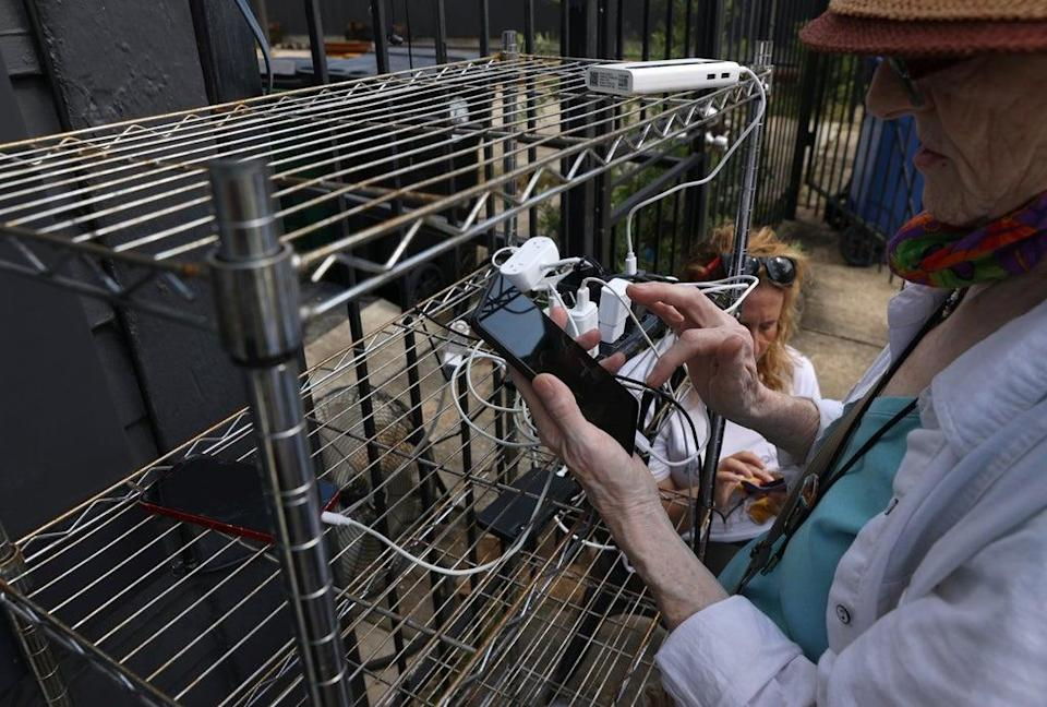 New Orleans residents created generator-powered charging stations after Hurricane Ida knocked out electricity to the city for nearly two weeks. (REUTERS)